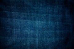Textura azul de la mezclilla con el espacio vacío imagenes de archivo