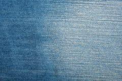 Textura azul de la mezclilla del dril de algodón y fondo inconsútil imagen de archivo