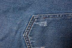 Textura azul de los pantalones vaqueros del dril de algodón Textura del fondo de los vaqueros de la mezclilla azul foto de archivo