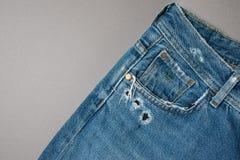 Textura azul de los pantalones vaqueros del dril de algodón Textura del fondo de los vaqueros de la mezclilla azul fotos de archivo