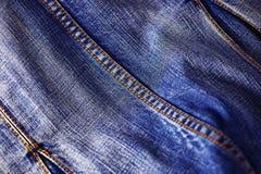 Textura azul de los pantalones vaqueros del dril de algodón Fotografía de archivo