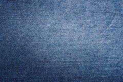 Textura azul de los vaqueros del dril de algodón Foto de archivo libre de regalías