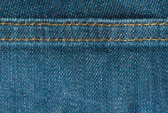 Textura azul de los vaqueros del dril de algodón con la costura, fondo Fotografía de archivo