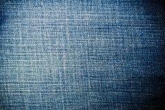 Textura azul gastada de los vaqueros del dril de algodón, fondo Fotografía de archivo
