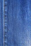 Textura azul y puntada de los vaqueros del dril de algodón Fotos de archivo