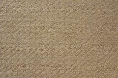 Textura beige oscura del fondo de la alfombra Fotos de archivo