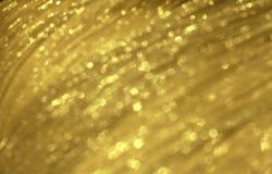 Textura borrosa festiva de oro brillante del tejido Contexto que brilla intensamente abstracto fotos de archivo