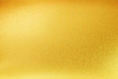 Textura brilhante do metal do sumário do ouro amarelo Foto de Stock Royalty Free