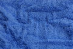 Textura brillante azul de un fragmento de un mantón de lana viejo Imagen de archivo libre de regalías