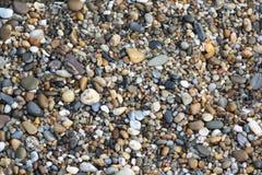 textura caliente de las piedras del guijarro de la playa Fotos de archivo libres de regalías