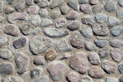 Textura cinzenta da pedra de uma terra com muitas pedras Imagem de Stock Royalty Free
