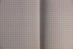 Textura cinzenta das folhas de um caderno em uma caixa Fotografia de Stock Royalty Free