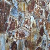 Textura cobblestoned maciça da parede fotografia de stock