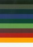 Textura coloreada de la tela imagenes de archivo