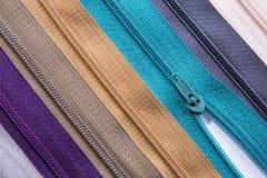 Textura colorida de las cremalleras para el fondo Imagen de archivo