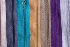 Textura colorida de las cremalleras para el fondo Imagenes de archivo