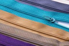 Textura colorida de las cremalleras para el fondo Imágenes de archivo libres de regalías