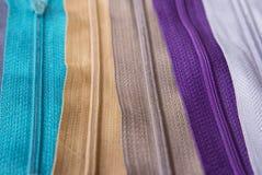 Textura colorida de las cremalleras para el fondo Fotografía de archivo