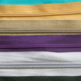 Textura colorida de las cremalleras para el fondo Imagen de archivo libre de regalías