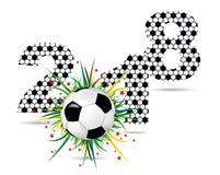 Textura com uma bola de futebol com grama e inscrição 2018 Imagens de Stock