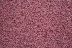 Textura concreta de la pared rojiza áspera y granosa imagen de archivo