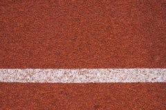 Textura corriente para todo clima de la pista del atletismo Fotografía de archivo