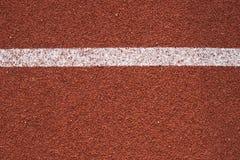 Textura corriente para todo clima de la pista del atletismo Foto de archivo