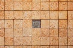 Textura cuadrada de los ladrillos con el pedazo que falta Imagen de archivo