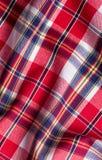 Textura a cuadros roja del fondo de la tela Fotos de archivo