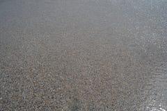 Textura da água e da areia Fotografia de Stock Royalty Free
