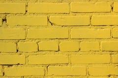 A textura da alvenaria Parede amarela Foto de Stock Royalty Free