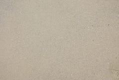 Textura da areia molhada do mar Fotografia de Stock