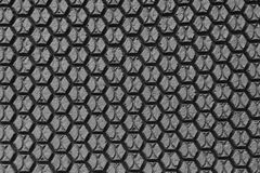 Textura da borracha do preto do hexágono Fotografia de Stock Royalty Free