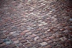 Textura da estrada do cobblestone do granito Imagens de Stock Royalty Free