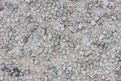 Textura da estrada molhada do cascalho Fotografia de Stock
