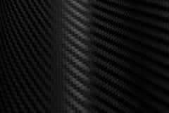 Textura da etiqueta da fibra do carbono Material preto luxuoso Fotos de Stock Royalty Free