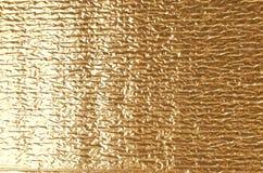 Textura da folha de alumínio do ouro Fotografia de Stock