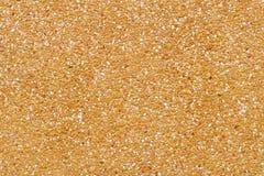 Textura da parede amarela do seixo para o teste padrão e o fundo Fotos de Stock