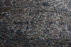 Textura da parede de pedra na obscuridade - cinza Foto de Stock Royalty Free