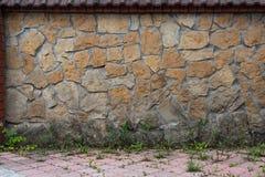 Textura da parede de pedra no pátio Imagem de Stock