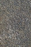 Textura da parede de pedra de pedras coloridas pequenas Fotografia de Stock