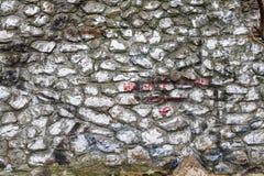 A textura da parede de pedra velha áspera pintada fotos de stock