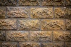 Textura da parede de tijolo com uma vinheta clara imagens de stock