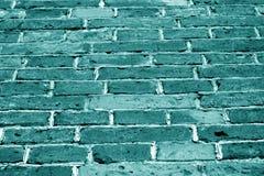 Textura da parede de tijolo do Grunge no tom ciano fotos de stock royalty free
