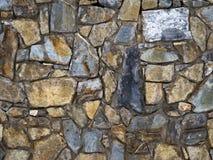 A textura da parede pavimentada com pedra fotografia de stock