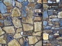 A textura da parede pavimentada com pedra imagens de stock royalty free