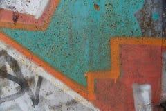 Textura da parede velha com grafittis coloridos Foto de Stock