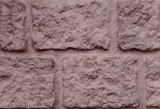 Textura da pedra decorativa, para o exterior Bordas desiguais Rosa e fundo pastel fotos de stock