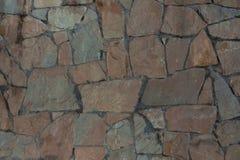 Textura da pedra rasgada Parede de pedra de Brown foto de stock royalty free