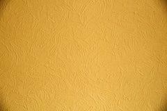 Textura da pintura amarela na parede Fotografia de Stock Royalty Free